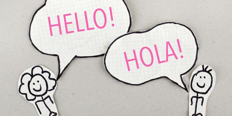 Pencil image of a woman saying hello in English and a man saying hello in Spanish