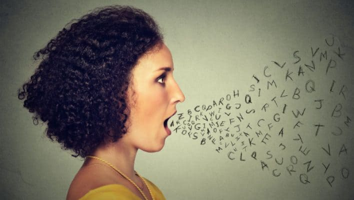 A woman speaking and letters coming out her mouth